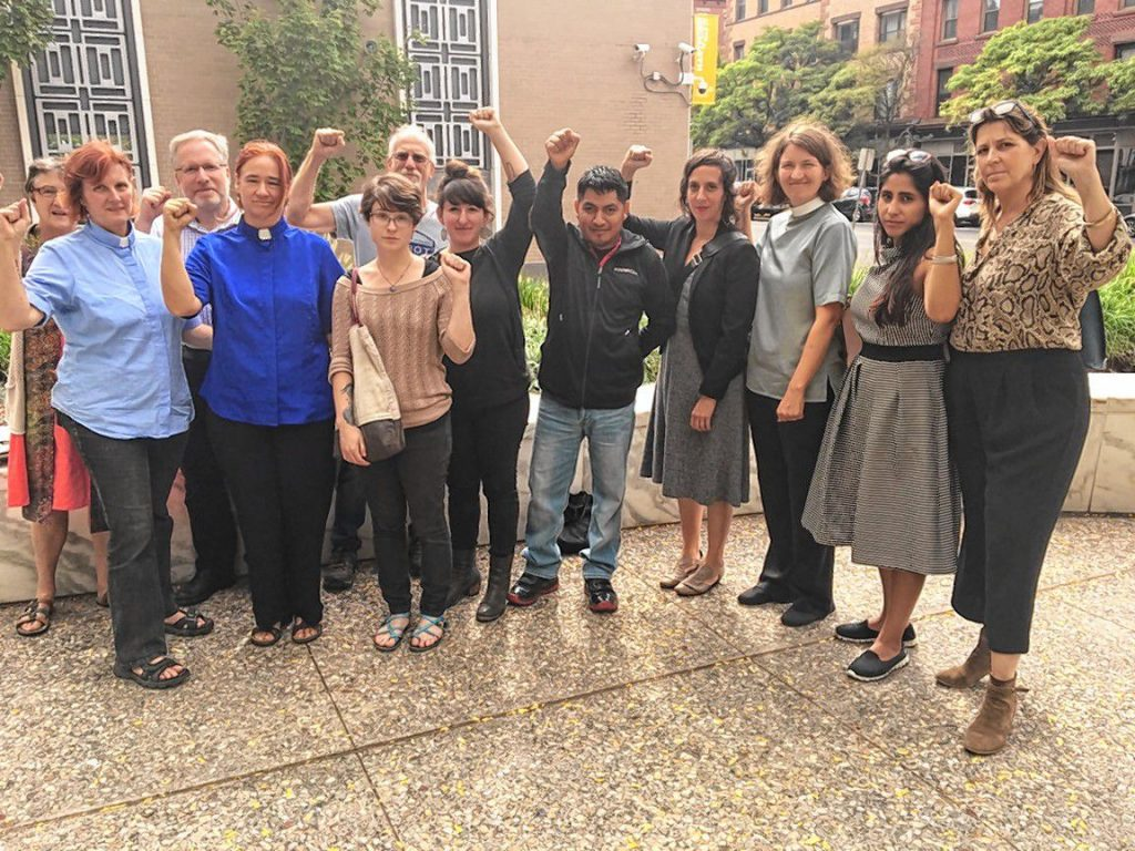 Lucio Perez Ortiz, center, who is facing deportation, stands with activists and members of the clergy outside the Immigration and Customs Enforcement (ICE) office in Hartford on Thursday, Sept. 14.