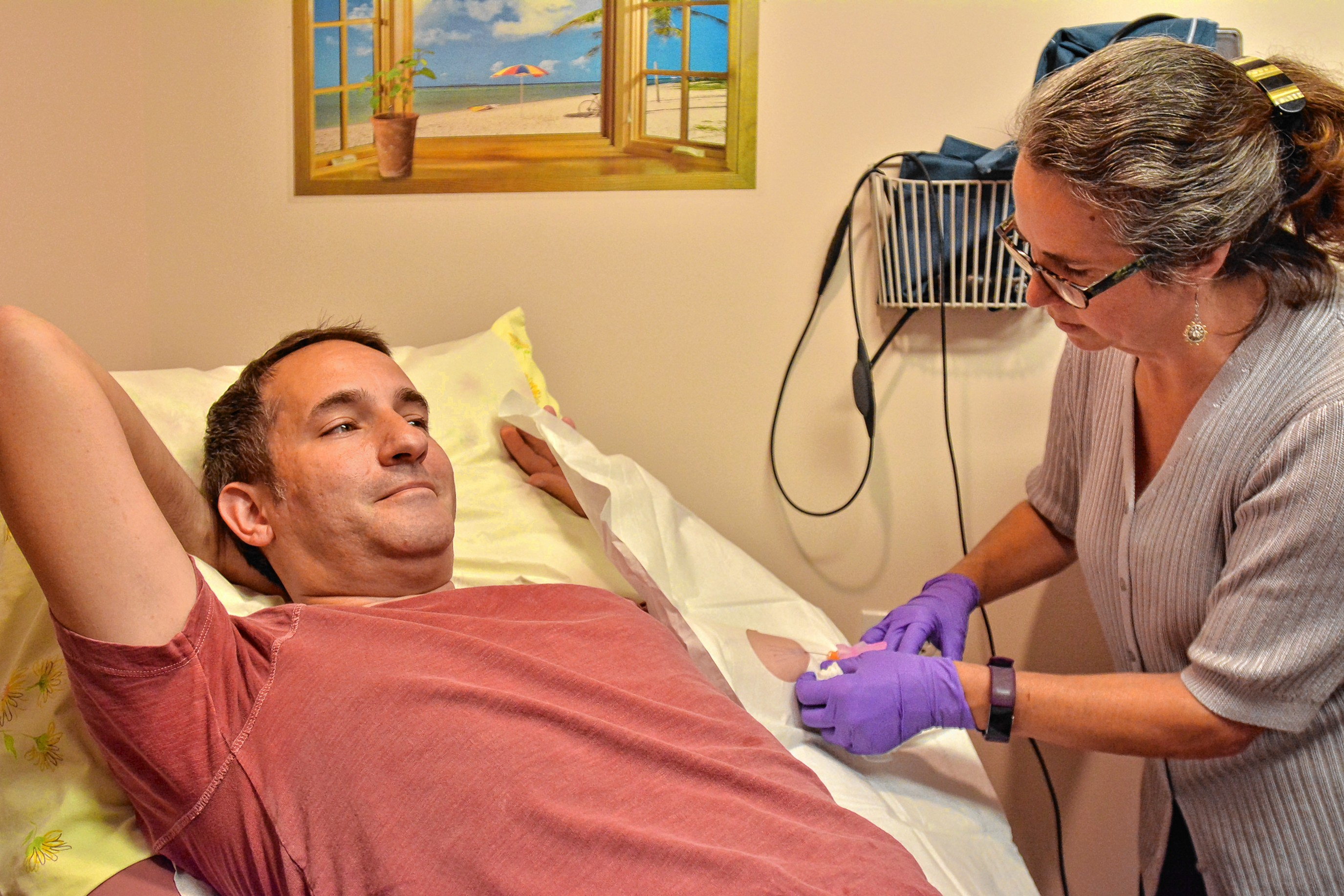 Dr. Kate Atkinson injects Jamey Summers with a local anesthetic to numb his  arm before inserting four buprenorphine implants at her office in Amherst  on ...