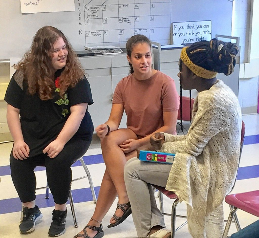 Aviva Weinbaum, center, speaks with other members of the Amherst Regional High School Women's Rights Club  Ayla Connor-Kirshbaum, left, and Lourdes Jean-Louis.
