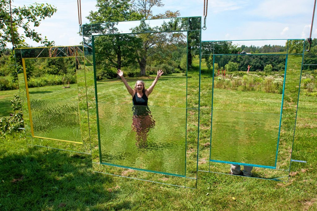 Easthampton artist Eileen Jager installs her piece, Through the Looking Glass at Park Hill Orchard in Easthampton on Wednesday, August 2, 2017, for the biennial Art In the Orchard show which opens Saturday, August 12.