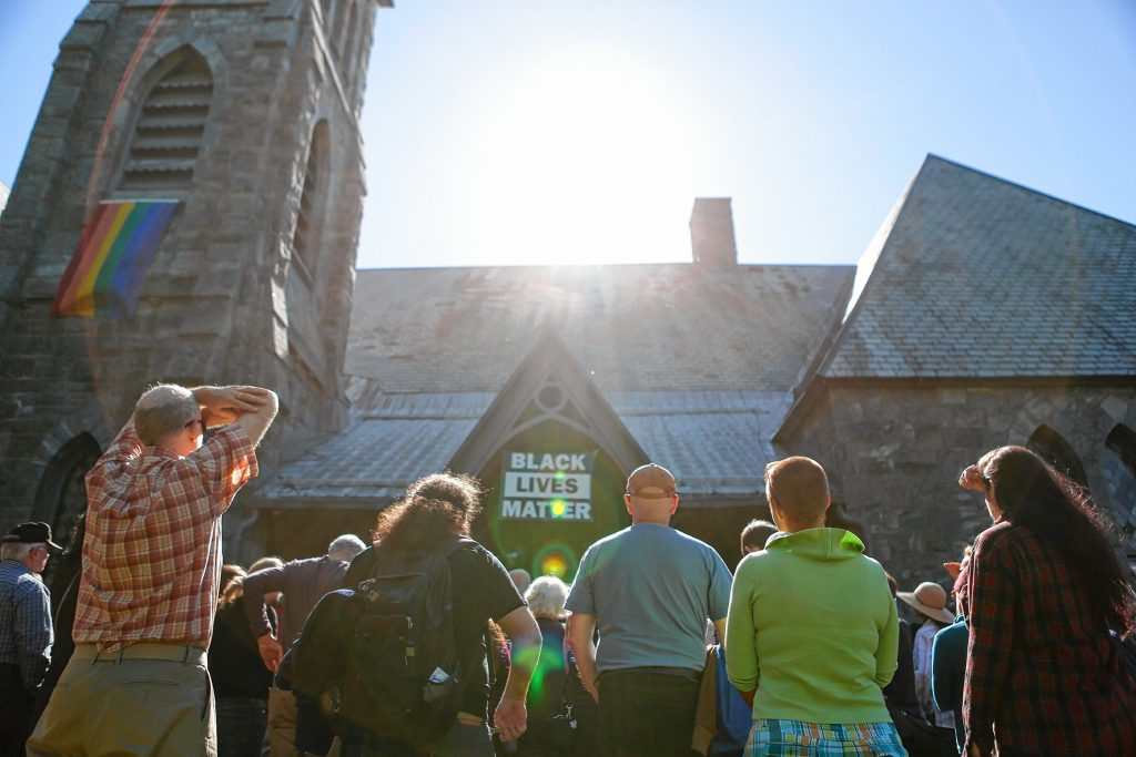 More than 150 people gather Oct. 19, 2017 in front of the First Congregational Church of Amherst, which is providing sanctuary to Lucio Perez of Springfield, an undocumented Guatemalan immigrant who is facing deportation. Perez is waiting for his case to be adjudicated by the Board of Immigration Appeals after Immigration and Customs Enforcement denied his stay of removal.