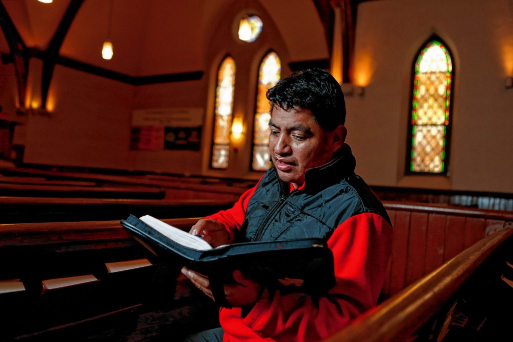 Lucio Perez of Springfield, an undocumented Guatemalan immigrant who is facing deportation, flips to a Bible passage that is particularly meaningful to him Nov. 2, 2017 at the First Congregational Church of Amherst, which is providing him sanctuary while he waits for his case to be reopened after Immigration and Customs Enforcement denied his stay of removal.
