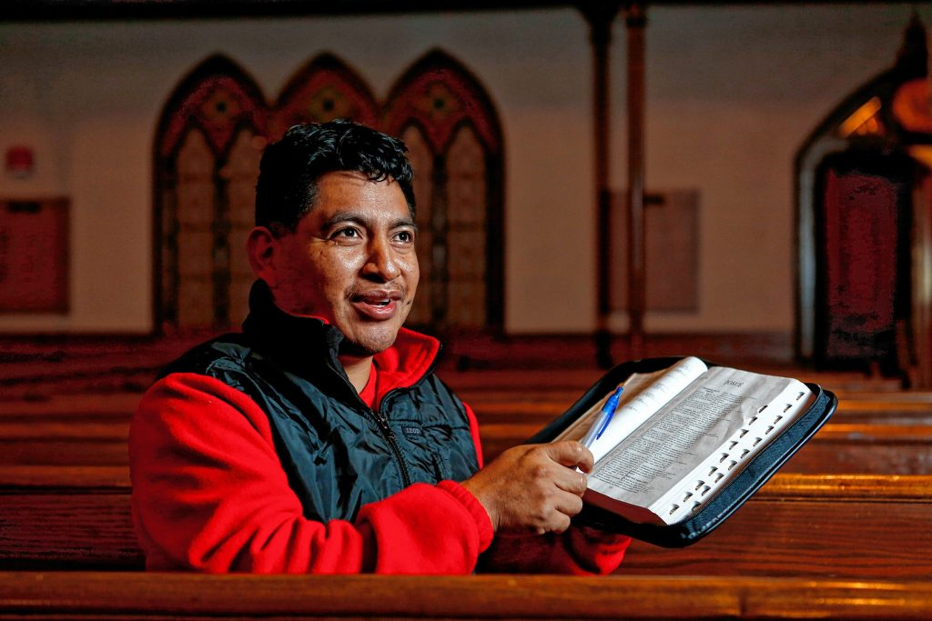 Lucio Perez of Springfield, an undocumented Guatemalan immigrant who is facing deportation, explains  Thursday that his faith gives him strength, at the First Congregational Church of Amherst.