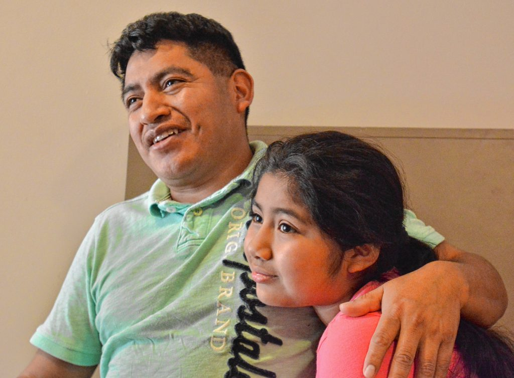 Lucio Perez, of Springfield, who is an undocumented immigrant who was facing deportation until he took refuge at First Congregational Church of Amherst Oct. 18, talks about his predicament, Saturday at the church. He is sitting with his daughter, Lucy, 8.