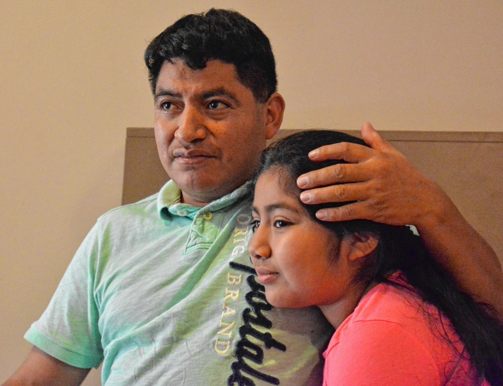 Lucio Perez, of Springfield, who is an undocumented immigrant who was facing deportation until he took refuge at First Congregational Church of Amherst Oct. 18, spends time with his daughter, Lucy, 8, Saturday at the church.