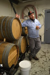 Jay Sullivan, co-owner and brewer at Honest Weight Artisan Beer, gives a tour of the Orange brewery's 24-barrel cellar. Hunter Styles photo.