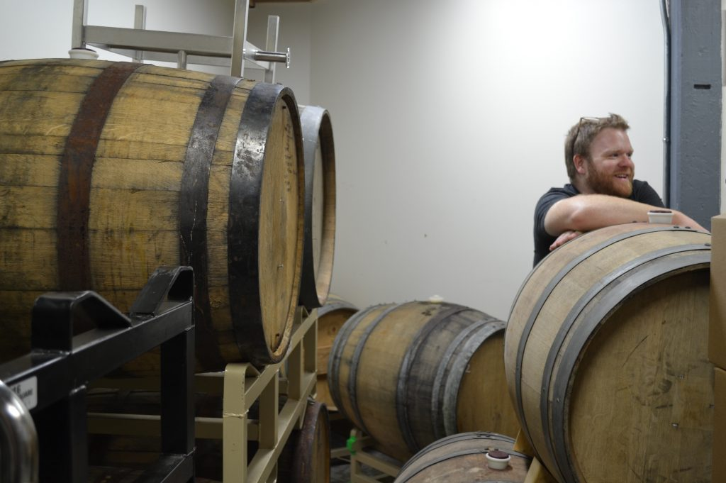 Sean Nolan, co-owner and brewer at Honest Weight Artisan Beer, checks the barrel cellar at the brewery in Orange. Hunter Styles photo.
