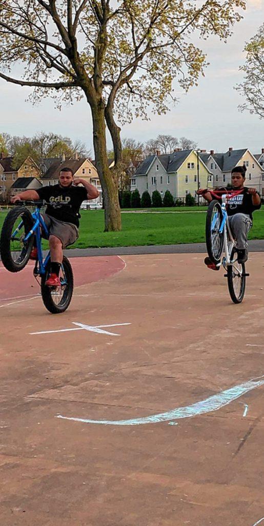Bikelife members doing tricks.