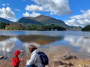 Katie Gartner and her son examine rocks at Muckross Lake in Killarney, Ireland.