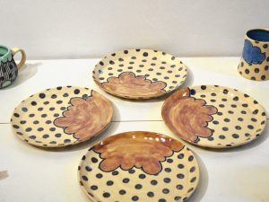 A collection of ceramic plates by artist Kayla McFarland.