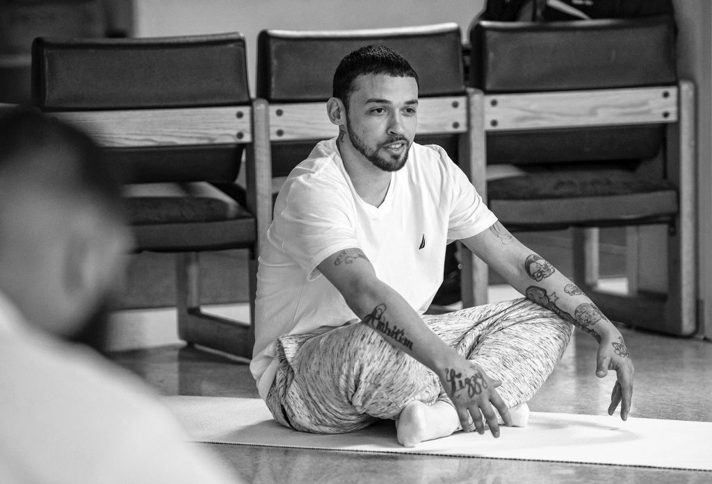 Johnny, an inmate at the Hampden County Pre-Release Center in Ludlow, talks about his experience with a yoga class that is part of the Cultivating, Honoring and Awakening Men's Potential program, or CHAMP, on Tuesday, April 30, 2019.