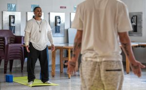 Steven, left, and Johnny, inmates at the Hampden County Pre-Release Center in Ludlow, take part in a yoga class in the Cultivating, Honoring and Awakening Men's Potential program, or CHAMP, on Tuesday, April 30, 2019.