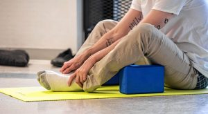 Shawn, an inmate at the Hampden County Pre-Release Center in Ludlow, takes part in a yoga class in the Cultivating, Honoring and Awakening Men's Potential program, or CHAMP, on Tuesday, April 30, 2019.