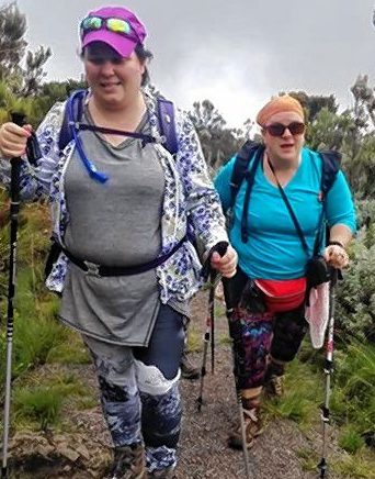 Christa Singleton, left and Eve Bogdanove, right, hiking up Mount Kilimanjaro in March.
