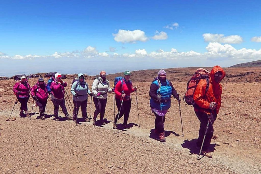 The Curvy Kili Crew hiking to Mount Kilimanjaro.
