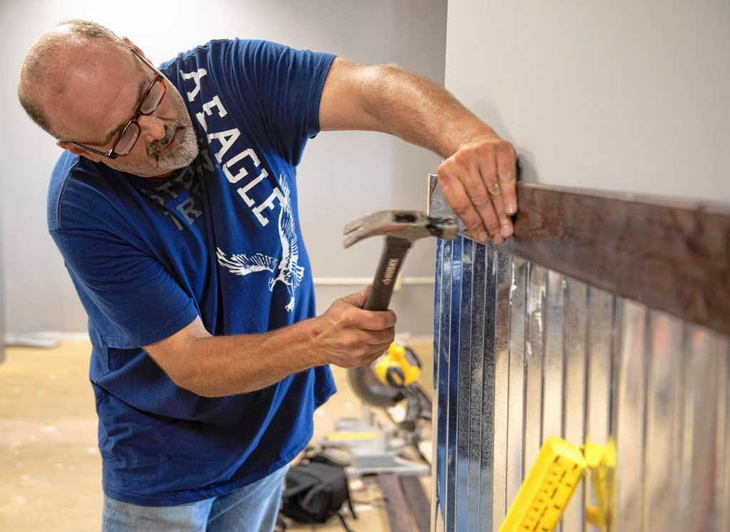 Frank Dailey, owner of Boston Bud Factory in Holyoke, works on the space that will be opening soon.