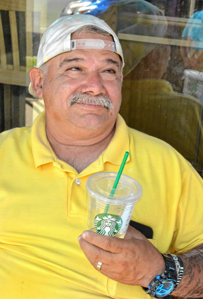 Rick Paiva, of Northampton, talks about vaping, Friday, Aug. 16, 2019 outside Starbucks in Northampton. He said he used to smoke and began to vape as an alternative to smoking, but no longer does either, due to health concerns.