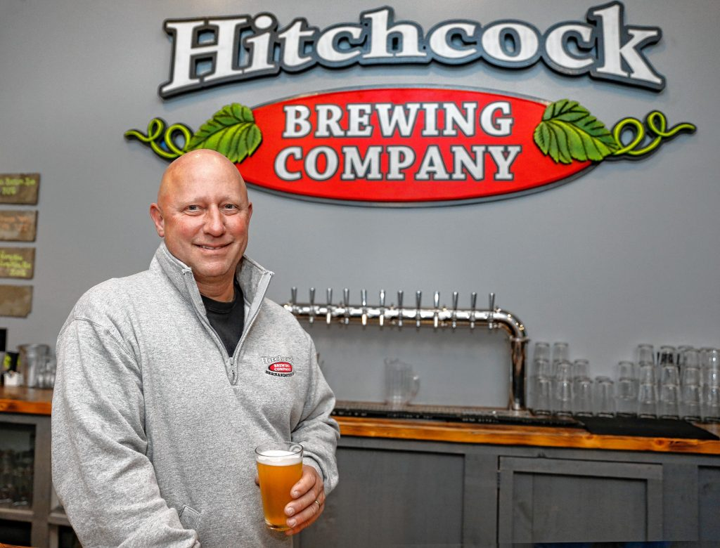 Hitchcock Brewing Company owner Rich Pedersen stands with a pint at the newly opened brewery and taproom at  203 South St. in Bernardston.