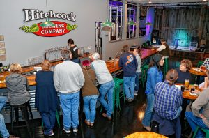 People gather in the taproom Thursday afternoon at the newly opened Hitchcock Brewing Company at 203 South St. in Bernardston.