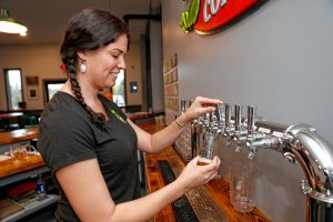 Bartender Erica Hebert pours a pint of Angry Sparrow on Thursday afternoon at the newly opened Hitchcock Brewing Company at 203 South St. in Bernardston.