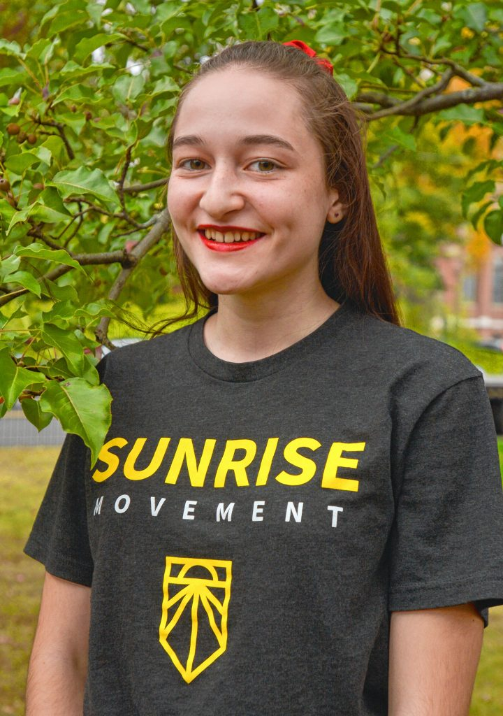 Kala Garrido, a Hampshire Regional High School student who is involved in the climate activist group Sunrise Northampton, at Forbes Library, Wednesday, Oct. 16, 2019.
