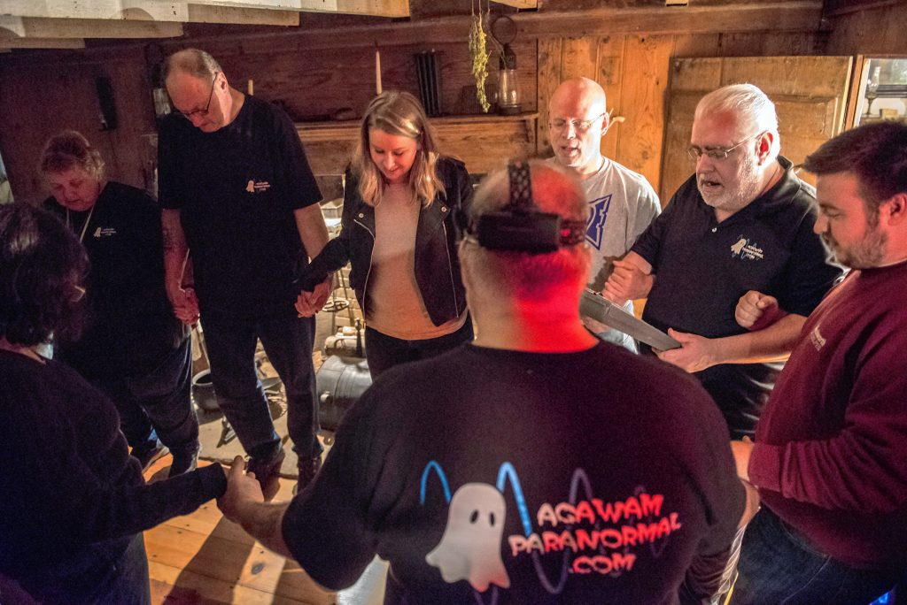 Agawam Paranormal director and lead investigator Rob Goff Sr., second from right, leads a prayer with his crew and other visitors in the original kitchen of the Josiah Day House in West Springfield  prior to an investigation there on Saturday evening, Sept. 14, 2019. Joining him are, clockwise from right, Ben Ashley Jr., Richard LaBombard, Christine Piquette, Joy Holhut, Ed Starkes, Sarah Forfa, Steve Svec and Goff.