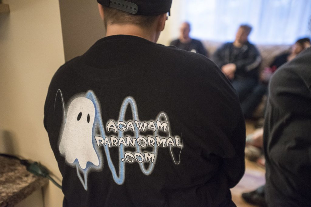 Agawam Paranormal senior investigator Heather Washburn of Southwick attends a pre-investigation briefing before heading to the Josiah Day House in West Springfield on Saturday evening, Sept. 14, 2019.