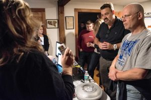 Steve Svec, right, and Dave Desmond listen as Liette Casey of Agawam Paranormal explains how to use a handheld detection device that each of the participants in the investigation will carry during an investigation at the Josiah Day House in West Springfield on Saturday evening, Sept. 14, 2019.