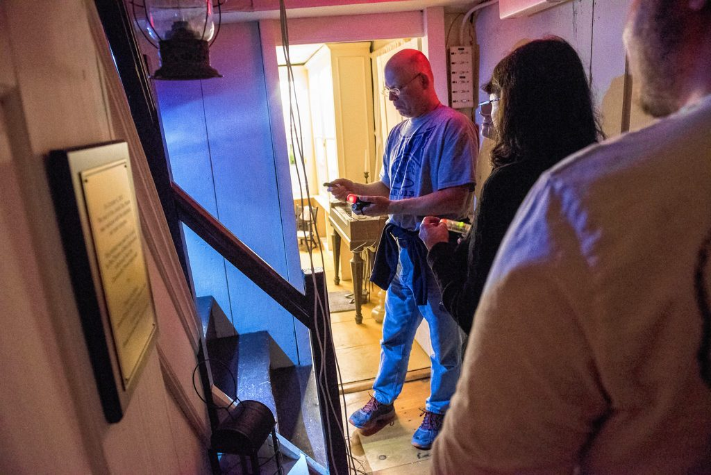 Steve Svec, left, of West Springfield notes some activity on the handheld detection device given to him by Agawam Paranormal during an investigation at the 1754 Josiah Day House in West Springfield on Saturday evening, Sept. 14, 2019.