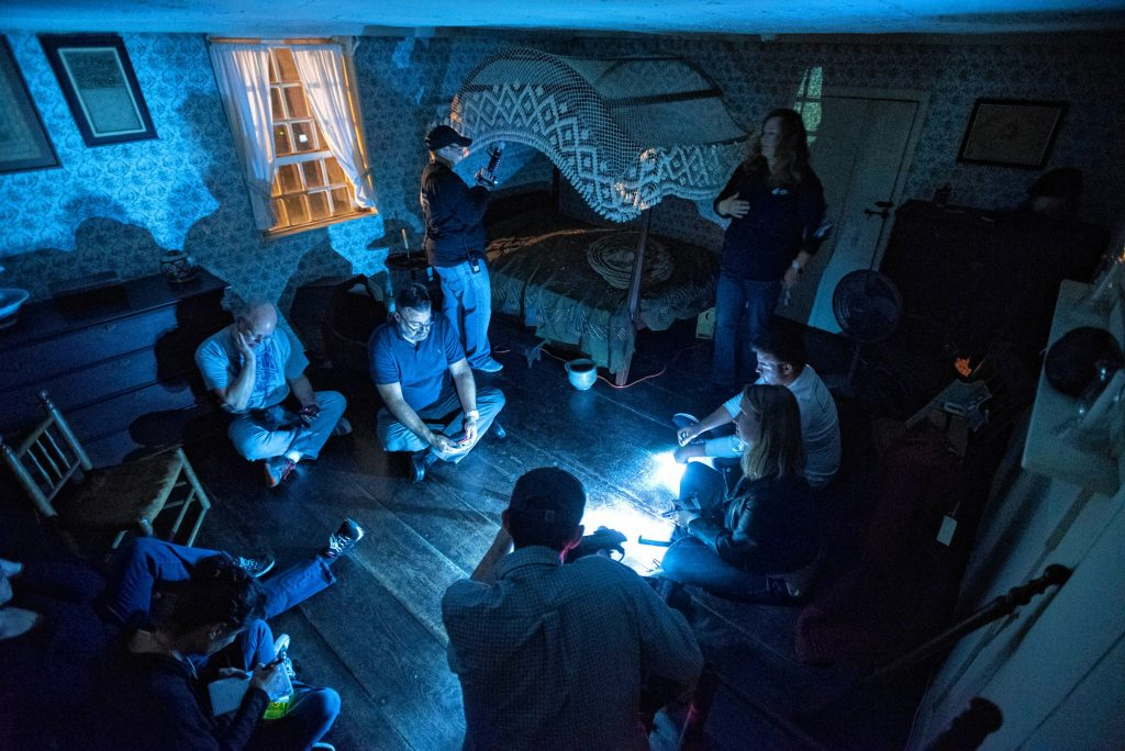 Liette Casey, upper right, with Agawam Paranormal leads an investigation in the upper floor of the 1754 Josiah Day House in West Springfield on Saturday evening, Sept. 14, 2019. The small lights are not from cell phones. Each of the participants carries with them at least one detection device - as well as a flashlight, if needed - during the investigations.
