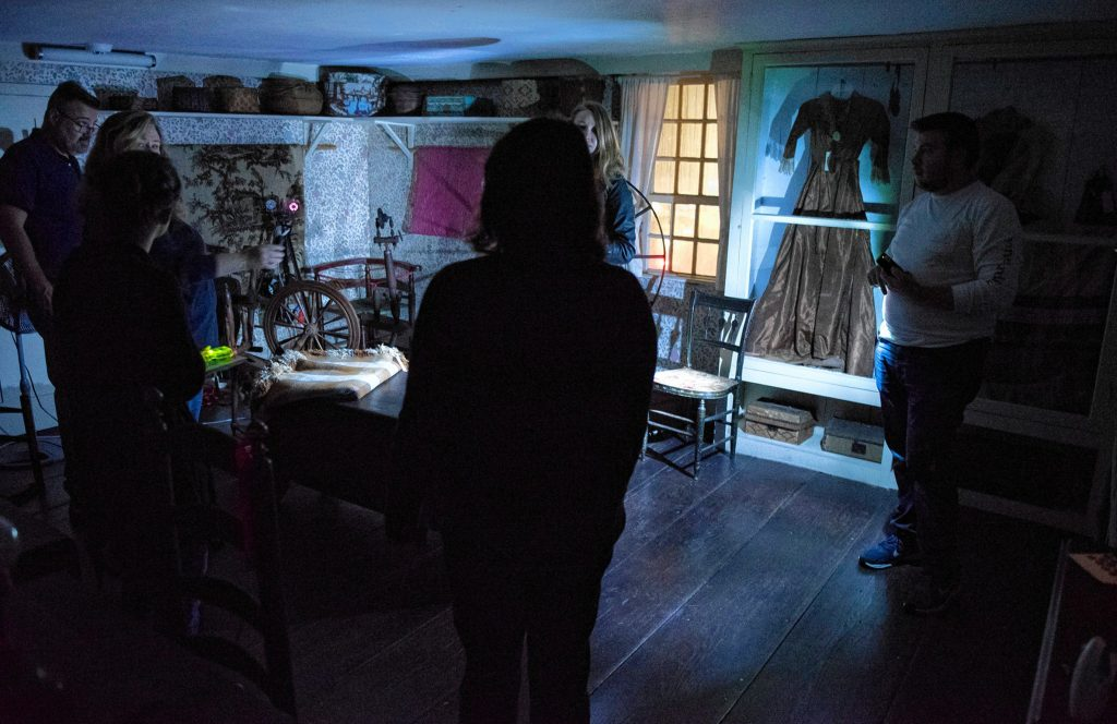 Liette Casey, second from left, with Agawam Paranormal leads an investigation on the ground floor of the 1754 Josiah Day House in West Springfield on Saturday evening, Sept. 14, 2019.
