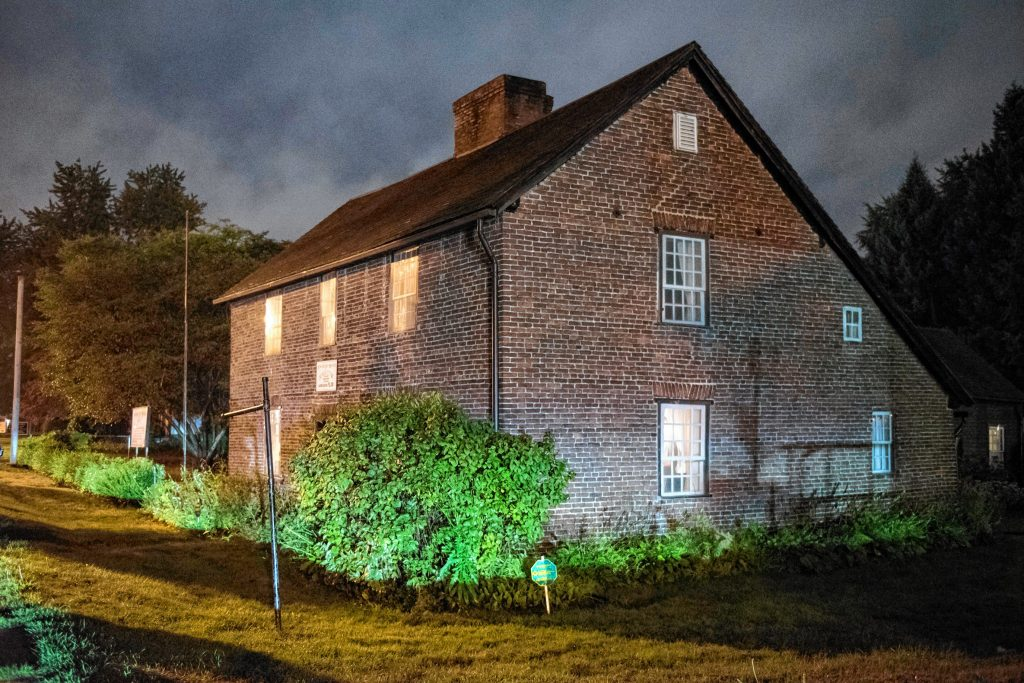 A view of the 1754 Josiah Day House on Elm Street in West Springfield during an investigation by Agawam Paranormal on Saturday evening, Sept. 14, 2019. The building, managed by the Ramapogue Historical Society, is said to be the oldest standing example of a brick saltbox design in the country.