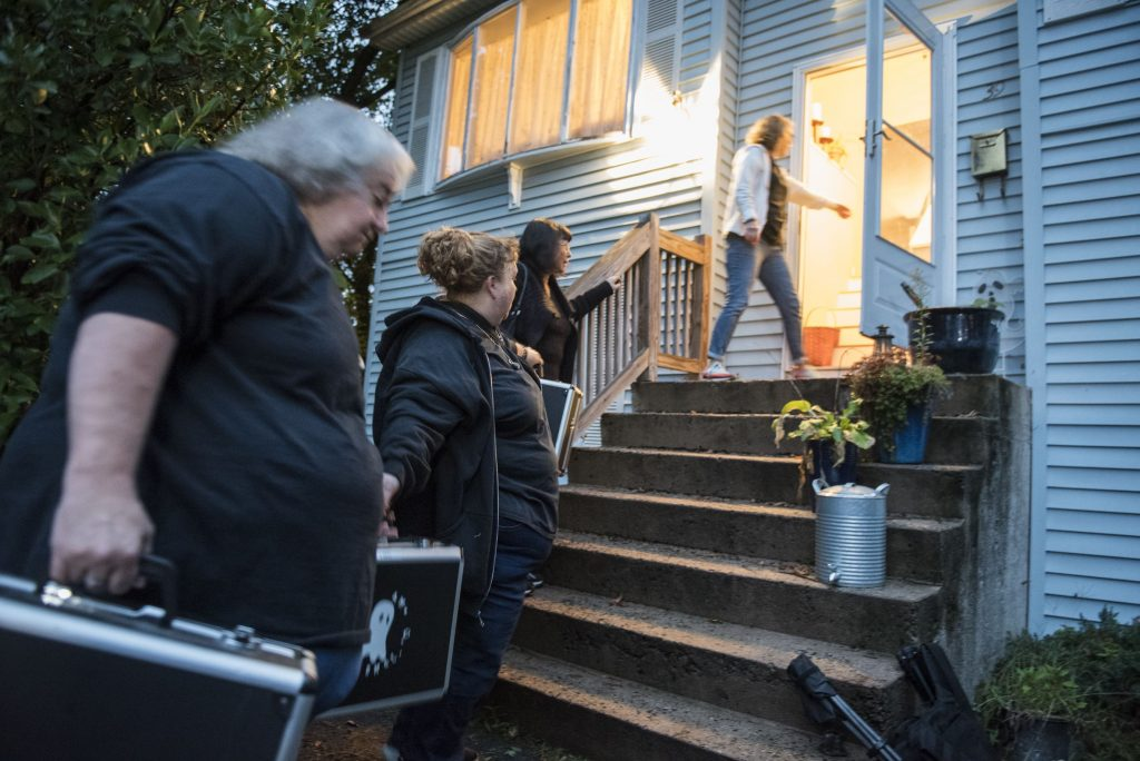 Members of Agawam Paranormal form a bucket brigade to load out a score of equipment cases to take to the Josiah Day House in West Springfield for an investigation on Saturday evening, Sept. 14, 2019. From left are Cindy Hall of Easthampton, Joy Holhut of Conway, Christine Piquette of South Hadley and Pam Raymond of East Longmeadow.