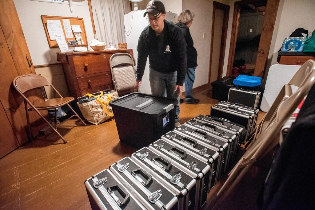 Agawam Paranormal senior investigator Heather Washburn of Southwick helps bring a score of equipment cases into the Josiah Day House in West Springfield for an investigation on Saturday evening, Sept. 14, 2019.