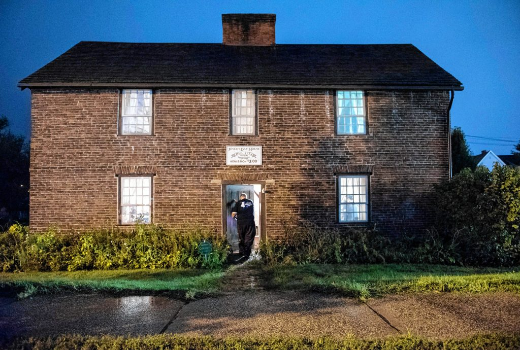 Agawam Paranormal senior investigator Richard LaBombard of Belchertown enters the 1754 Josiah Day House in West Springfield for an investigation on Saturday evening, Sept. 14, 2019.