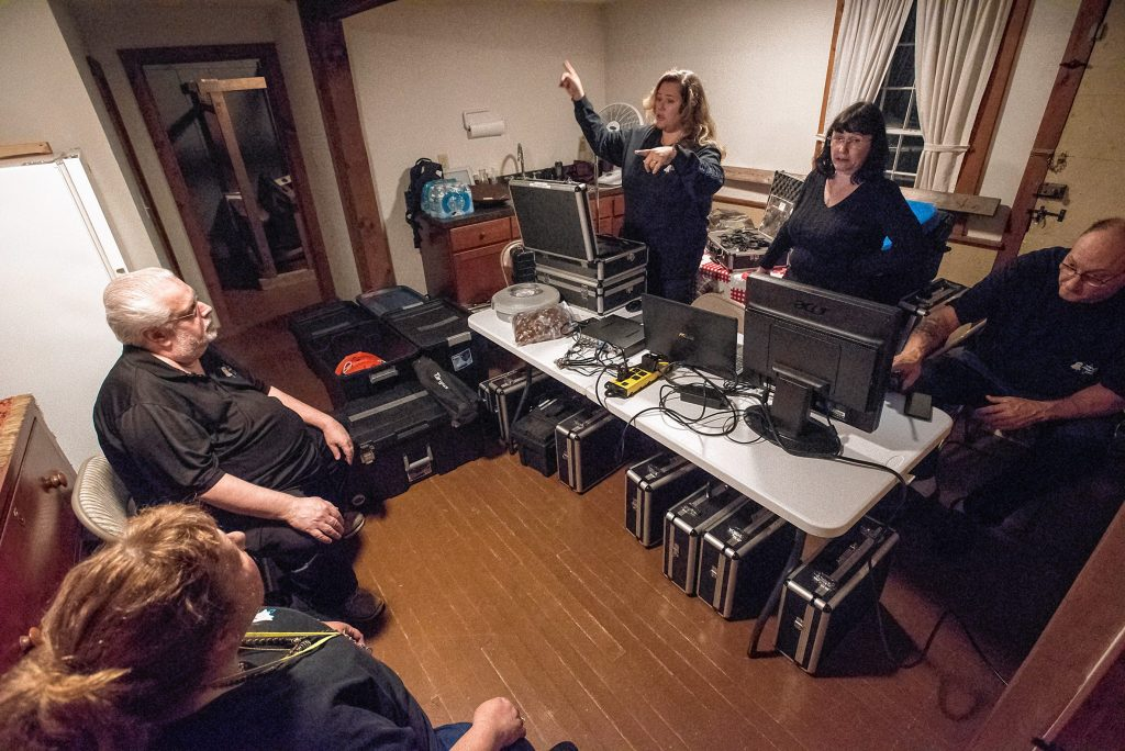 Agawam Paranormal director and lead investigator Rob Goff Sr., second from left, and his crew discuss their set up for an investigation at the Josiah Day House in West Springfield on Saturday evening, Sept. 14, 2019. From left are Joy Holhut of Conway, Liette Casey of Springfield, Christine Piquette of South Hadley and Ed Starkes of Somers, Connecticut.