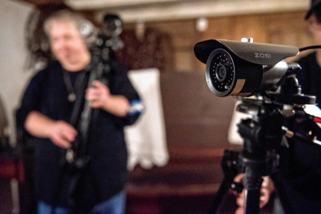 Agawam Paranormal investigator Cindy Hall of Easthampton sets up cameras and other monitoring equipment on the first floor of the Josiah Day House in West Springfield on Saturday evening, Sept. 14, 2019.