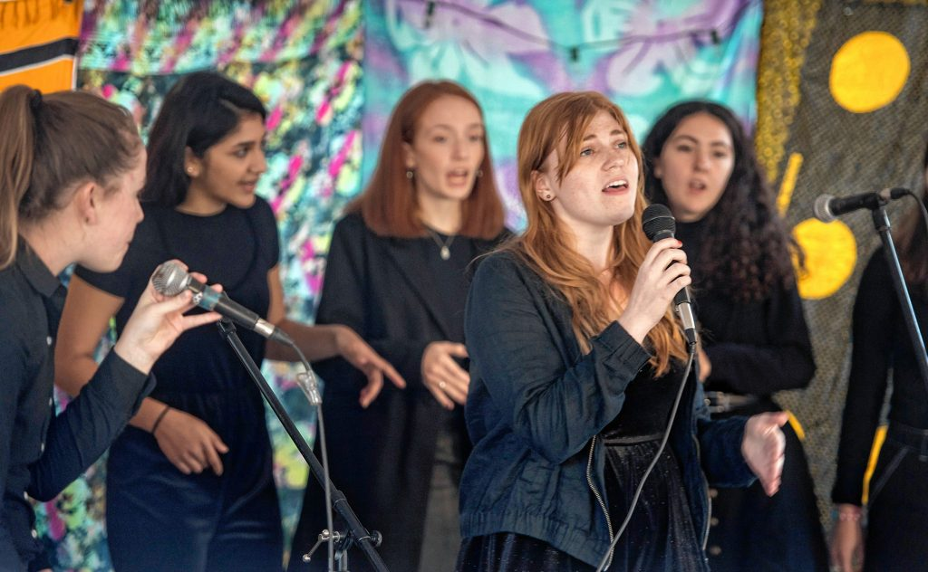 "Abigail McDonough and the University of Massachusetts a cappella group S#arp Attitude perform ""Alive"", by Sia, during the Dwellings Arts Festival held at the Northampton Center for the Arts on Saturday, Oct. 12, 2019."