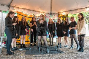 "Abigail McDonough, center, takes a solo with the University of Massachusetts' only all-female-identified a cappella group, S#arp Attitude, during a performance at the Dwellings Arts Festival held at the Northampton Center for the Arts on Saturday, Oct. 12, 2019. Their set included ""Alive"" by Sia, ""God is a Woman"" by Ariana Grande, ""Work Song"" by Hozier, ""Who's Lovin' You"" by Smokey Robinson, a mashup of ""Sail"", by Aaron Bruno, and ""River"", by Sarah Grace McLaughlin, and concluded with their alumni song, ""Burning Down""."