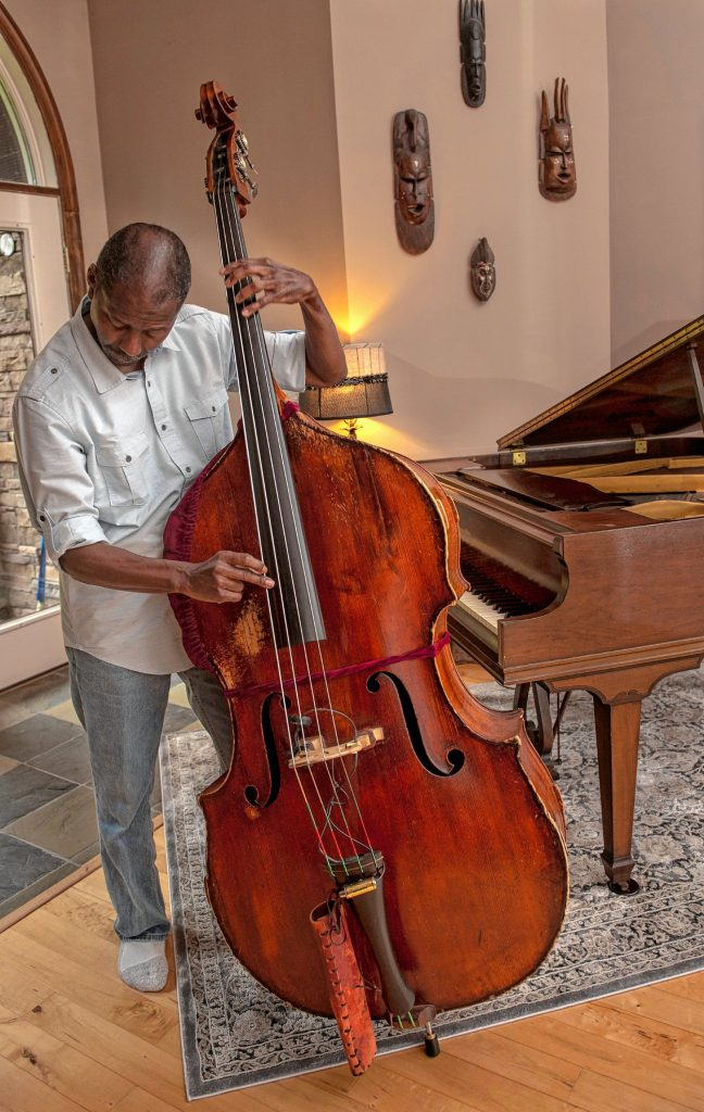 Sharpe, seen here in Plainfield home, is an acclaimed bassist who has played and recorded with a host of jazz legends, from McCoy Tyner to Wynton Marsalis.