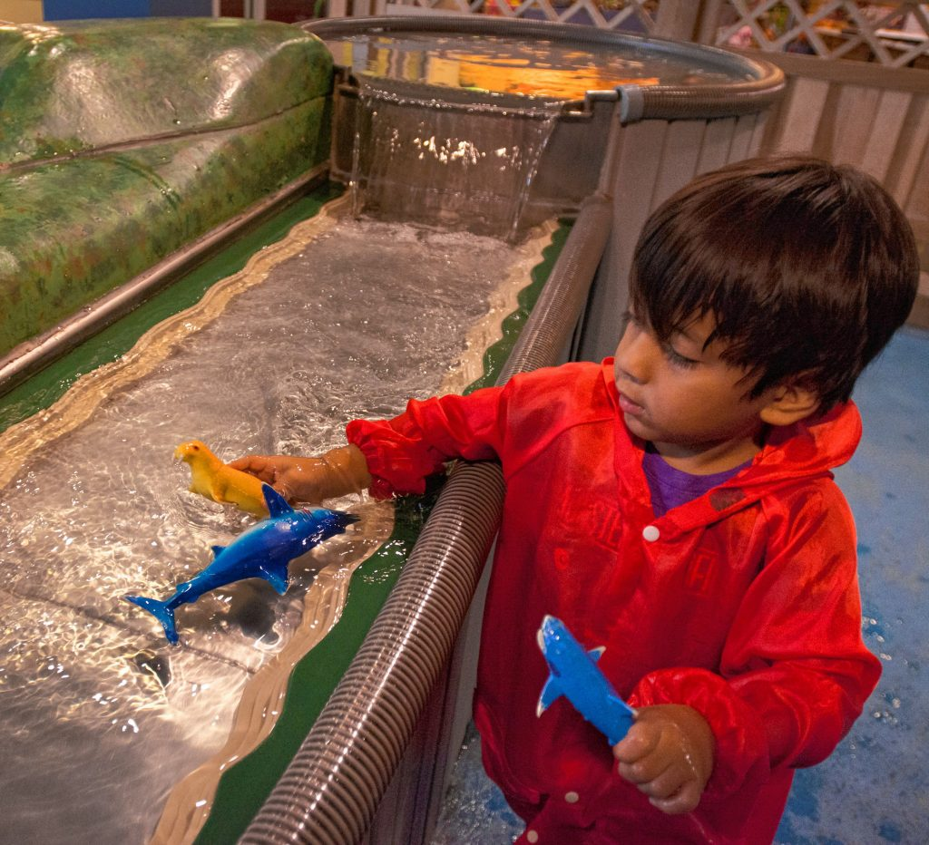 Ray Tibbitt, 4, plays on a water table, Friday, Oct. 25, 2019 at Holyoke Children's Museum. Though he is not autistic and does not have sensory processing disorders, the activity is suitable for those who do and is offered during the museum's Sensory Sundays. He was with his grandmother, Peggy Tibbitt, of Belchertown.