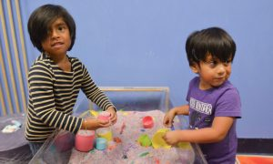 Esther Tibbitt, 5, and Ray Tibbiitt, 4, play on a sensory table, Friday at Holyoke Children's Museum. Though these children are not autistic and do not have sensory processing disorders, the activity is popular and suitable for those who do and is offered during the museum's Sensory Sundays. The children were with their grandmother, Peggy Tibbitt, of Belchertown.
