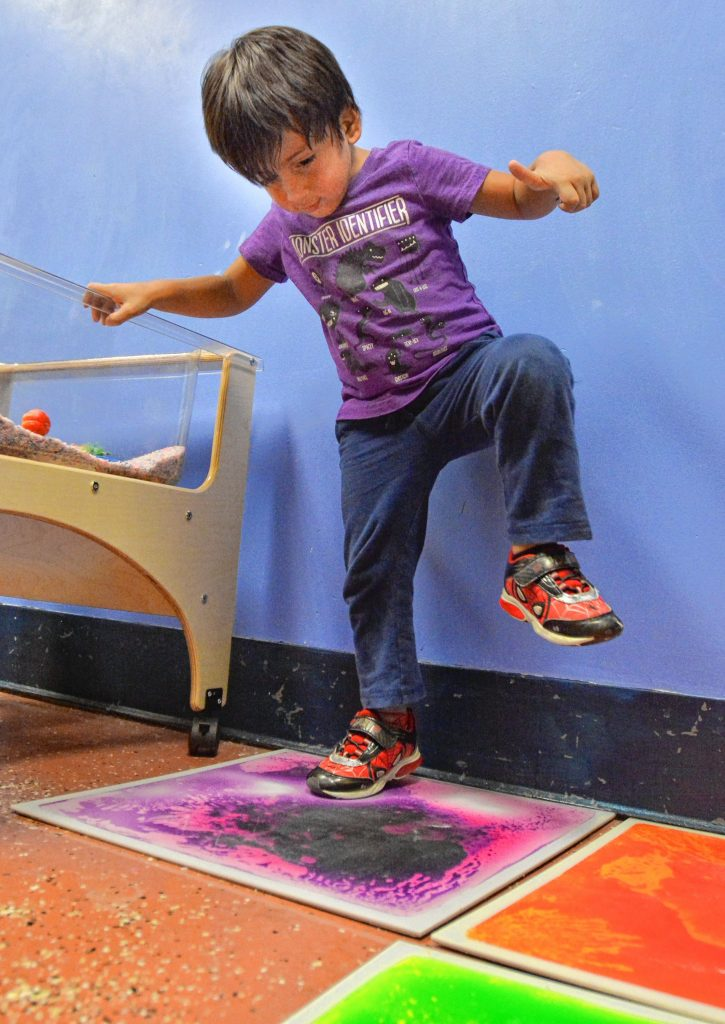 Ray Tibbitt, 4, plays on a Spooner Surfloor liquid tiles, at Holyoke Children's Museum. Though he is not autistic and does not have sensory processing disorders, the activity is popular and suitable for those who do and is offered during the museum's sensory Sundays. He was with his grandmother, Peggy Tibbitt, of Belchertown.
