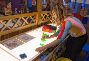 Lauren Boyce, who is the operations manager at Holyoke Children's Museum, describes the use of a Magna Tile Table at the museum. It is one of the activities offered by the museum's sensory Sundays.