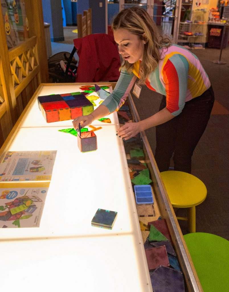 Lauren Boyce, who is the operations manager at Holyoke Children's Museum, describes the use of a Magna Tile Table, Friday, Oct. 25, 2019 at the museum. It is one of the activities offered by the museum's Sensory Sundays.