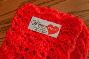 A scarf crocheted by Lynette Bloise for WomenHeart rests on a table at her home in Pelham, Thursday, Oct. 31, 2019.