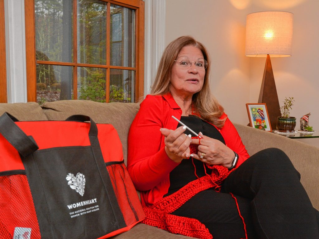 Lynette Bloise, who has become a WomenHeart champion, crochets a scarf as she talks about her work with the group, Thursday, Oct. 31, 2019 at her home in Pelham.