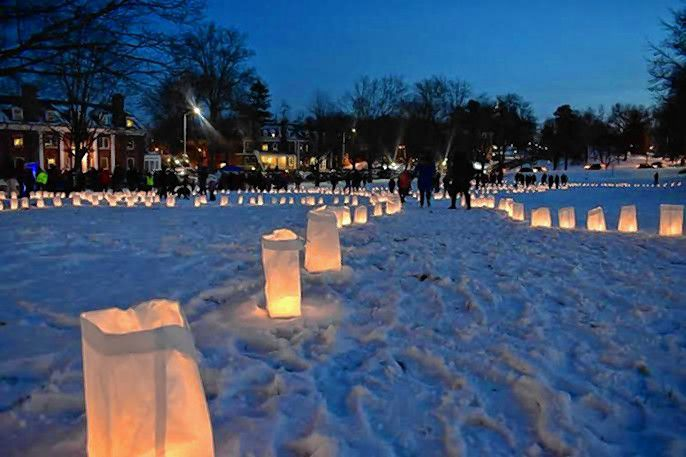 Candles create pathways during a previous Luminaria in Amherst.