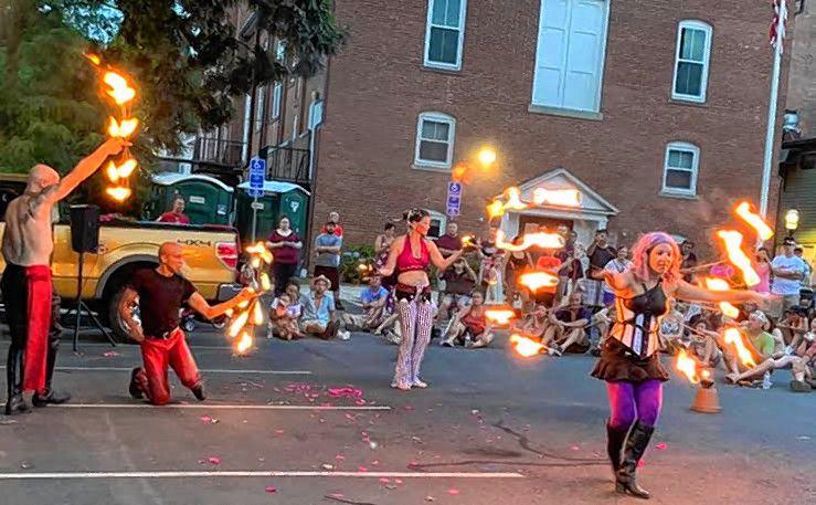 Matica Circus performers juggle fire.