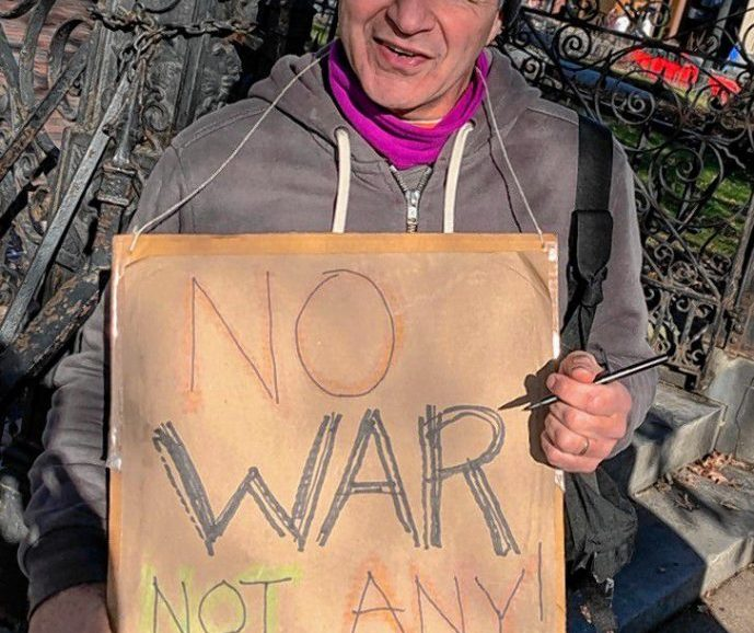 "Dave Madeloni with his ""No War / Not Any!"" sign."